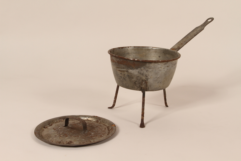 2005.174.6 a-b open Aluminum tripod sauce pot with lid from cafe used as rendezvous point by French resistance