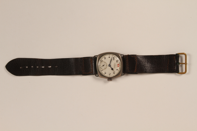 2005.198.2 front Wrist watch with a brown band and engraved initials saved from Vilna ghetto