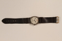Wrist watch with a brown band and engraved initials saved from Vilna ghetto