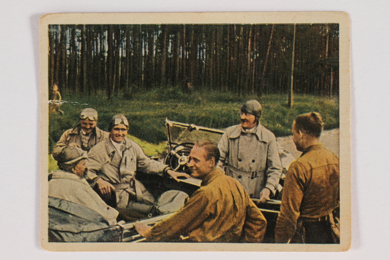 2005.315.3 front Cigarette card with image of Hitler and Nazi Party members in an open car