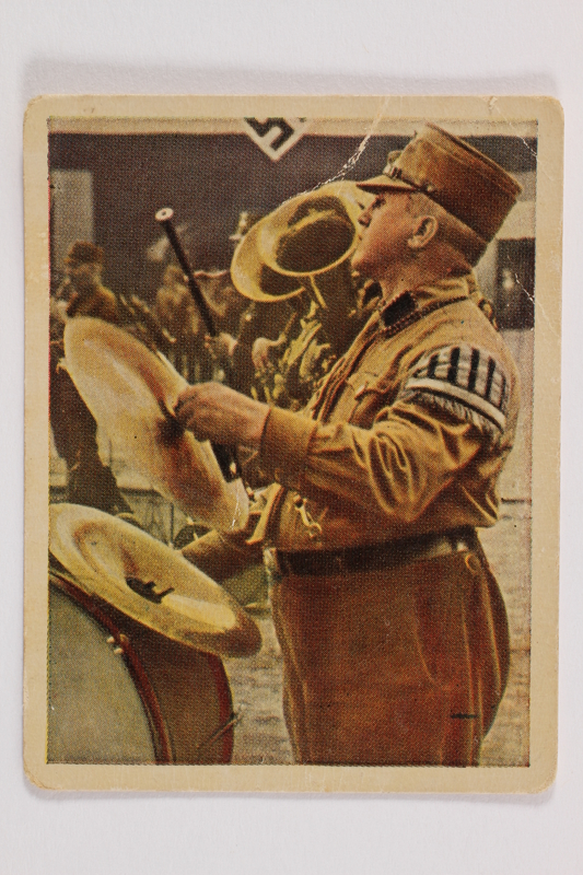 2005.315.5 front Cigarette card with image of Nazi party band in performance