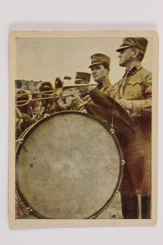 2005.315.6 front Cigarette card with image of Nazi party band in performance