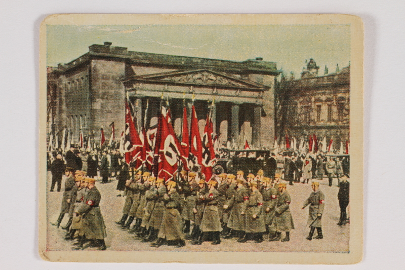 2005.315.7 front Cigarette card with image of Nazi military parade