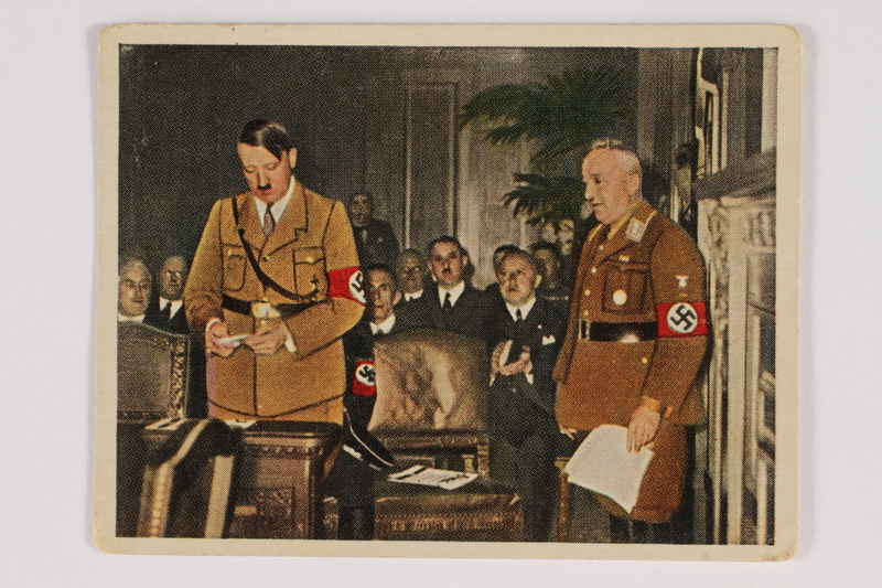 2005.315.8 front Cigarette card depicting Hitler addressing the German Congress