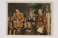 2005.315.8 front Cigarette card depicting Hitler addressing the German Congress  Click to enlarge