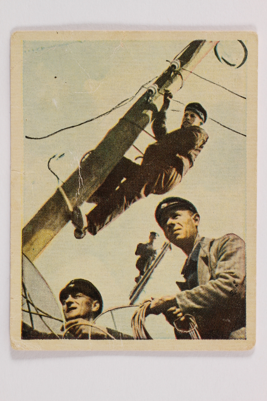 2005.315.10 front Cigarette card with image of a Nazi Party festival