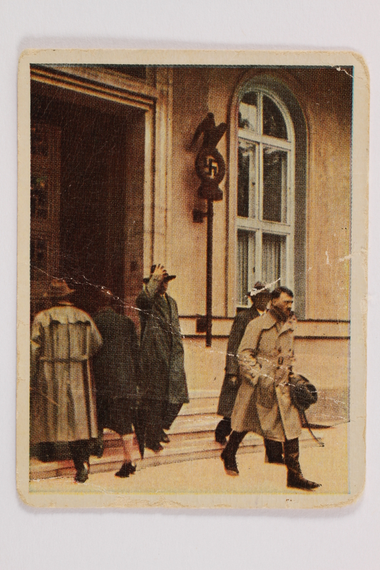2005.315.12 front Cigarette card depicting Hitler leaving Nazi Party headquarters in Munich