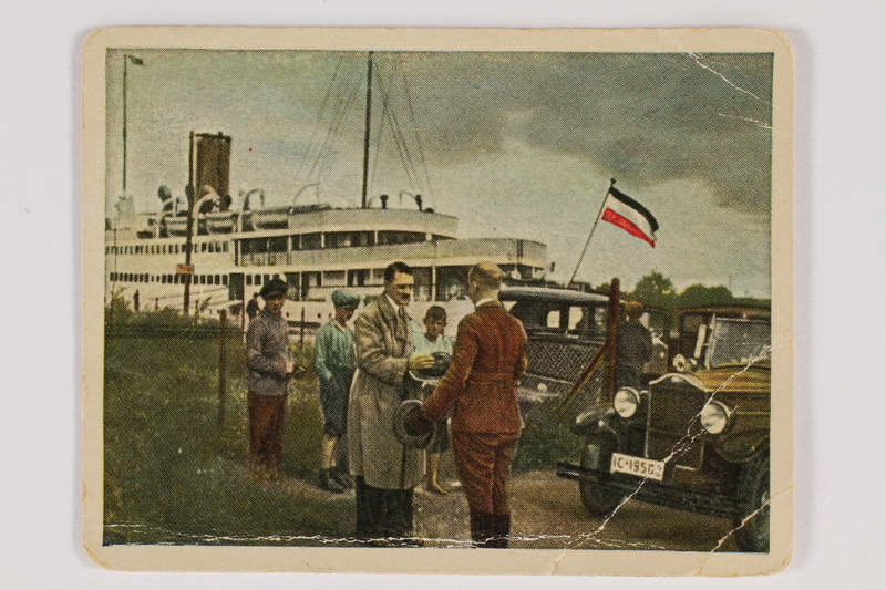 2005.315.14 front Cigarette card depicting Hitler traveling in Prussia
