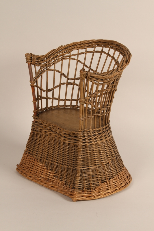 2005.316.1 front Child's wicker chair received by a toddler for her birthday while in hiding