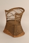 Child's wicker chair received by a toddler for her birthday while in hiding