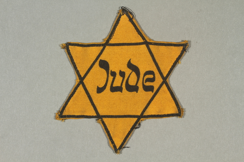 2003.361.13 front Star of David badge imprinted Jude worn by a German Jew