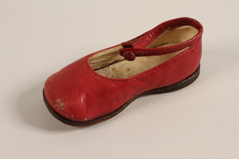 1996.165.2  b front Pair of red leather toddler's shoes worn by a child in Łódź Ghetto