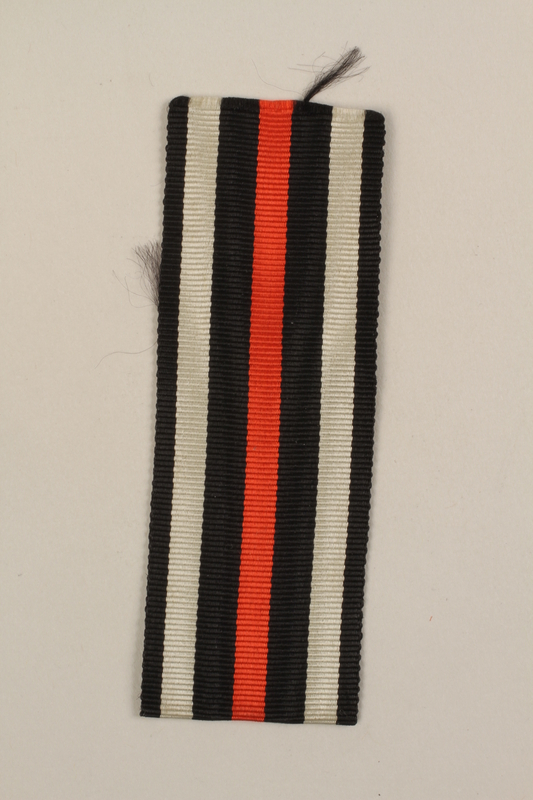 2005.492.3 front WWI German military black and white striped ribbon that belonged to a Jewish veteran and concentration camp inmate