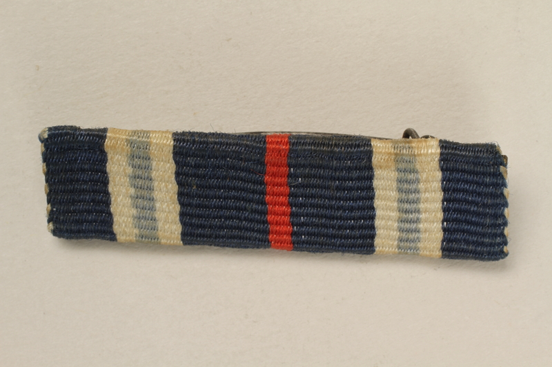 2005.492.4 front Blue, white and red bar ribbon that belonged to a Jewish German WWI veteran and concentration camp inmate