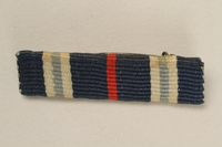 2005.492.4 front Blue, white and red bar ribbon that belonged to a Jewish German WWI veteran and concentration camp inmate  Click to enlarge