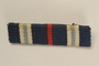 Blue, white and red bar ribbon that belonged to a Jewish German WWI veteran and concentration camp inmate