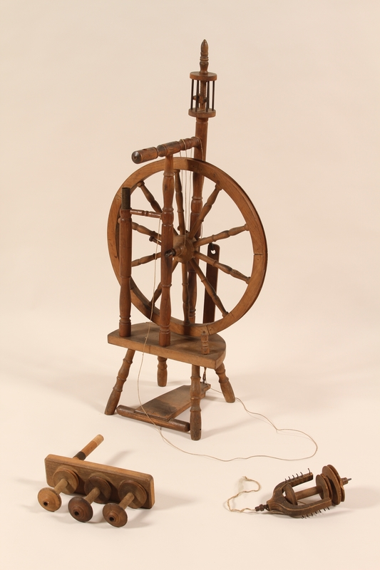 2005.523.2 a-i front Wooden spinning wheel used while in hiding in Belgium