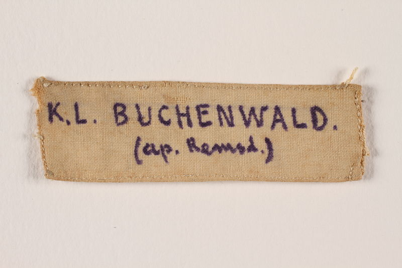2005.567.4 front Handmade prisoner badge worn by a Latvian Jewish concentration camp inmate
