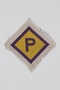 Unused forced labor badge, yellow with a purple P, to identify a Polish forced laborer