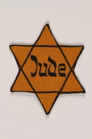 2005.579.5 front Star of David yellow patch with Jude worn by a German Jewish concentration camp inmate  Click to enlarge