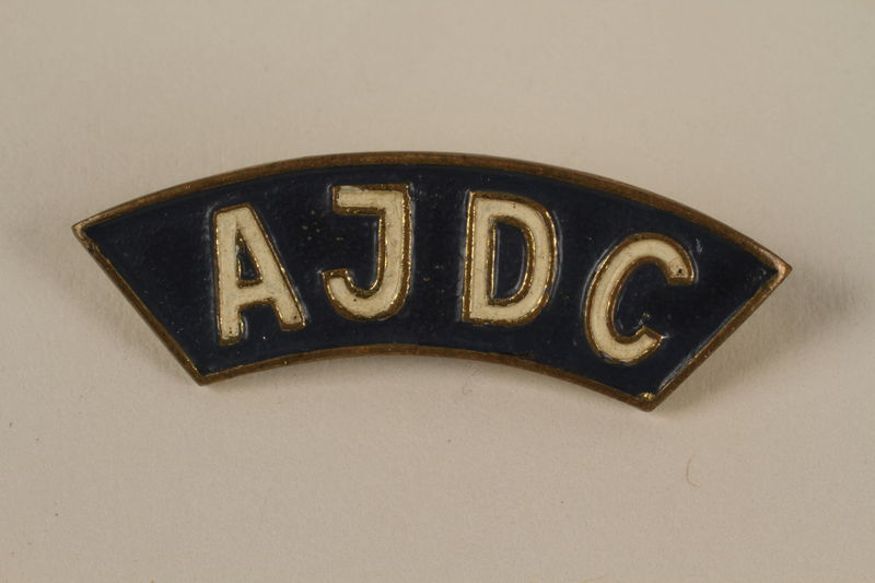 2005.579.13 front American Jewish Joint Distribution Committee blue pin worn by a former concentration camp inmate and refugee aid worker