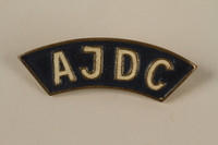 2005.579.13 front American Jewish Joint Distribution Committee blue pin worn by a former concentration camp inmate and refugee aid worker  Click to enlarge