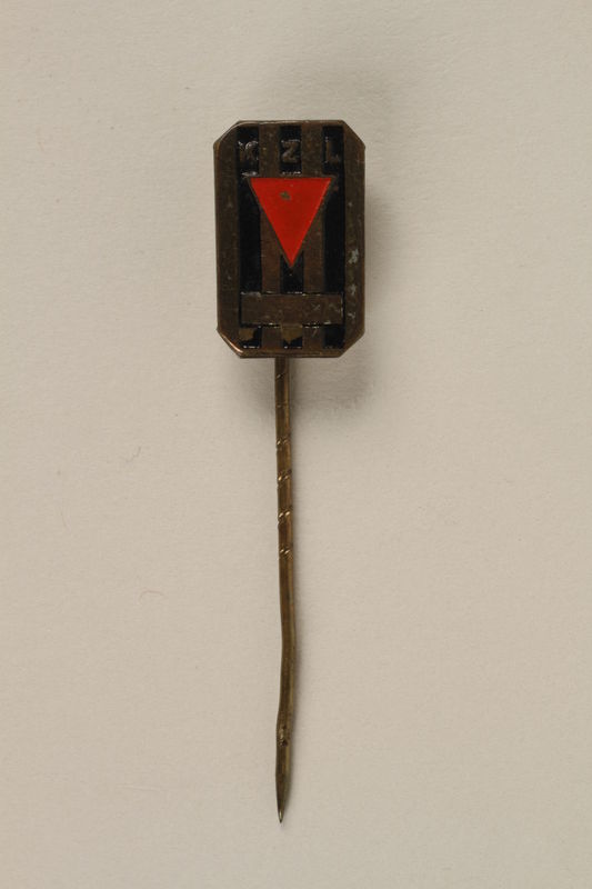 2005.579.17 front Commemorative concentration camp pin worn postwar by a former concentration camp inmate and refugee aid worker