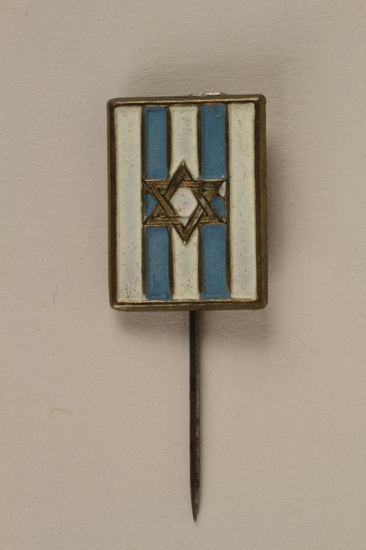 2005.579.18 front Stickpin with a Star of David on a blue and white field worn postwar by a former concentration camp inmate and refugee aid worker