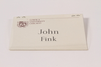 2005.579.10 Paper name tag in plastic worn postwar by a former concentration camp inmate and dp camp relief worker  Click to enlarge