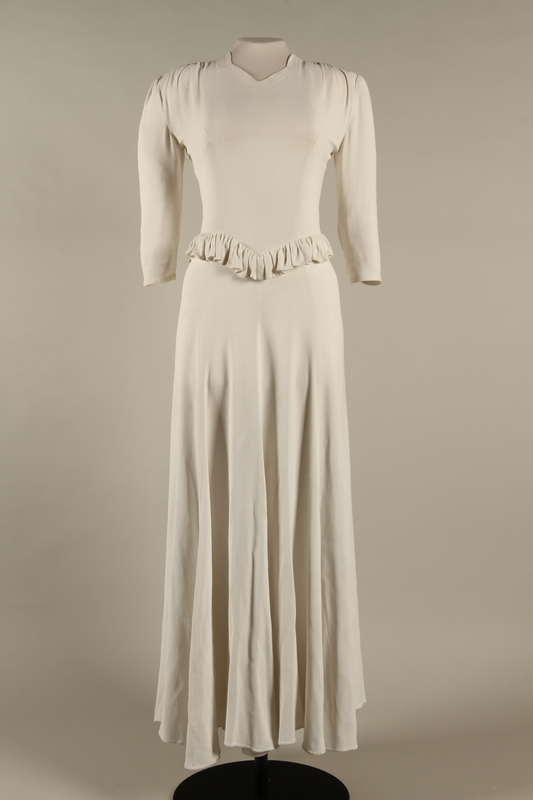 2005.579.2  front Wedding dress with ruffle made for the marriage of 2 German Jewish DP camp aid workers