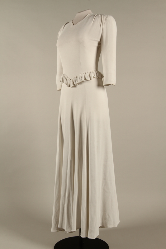 2005.579.2 3/4 left Wedding dress with ruffle made for the marriage of 2 German Jewish DP camp aid workers