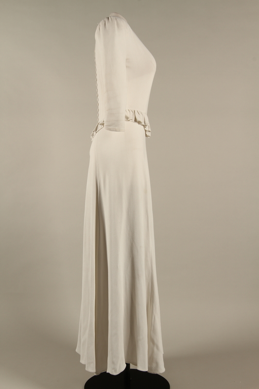2005.579.2 right Wedding dress with ruffle made for the marriage of 2 German Jewish DP camp aid workers