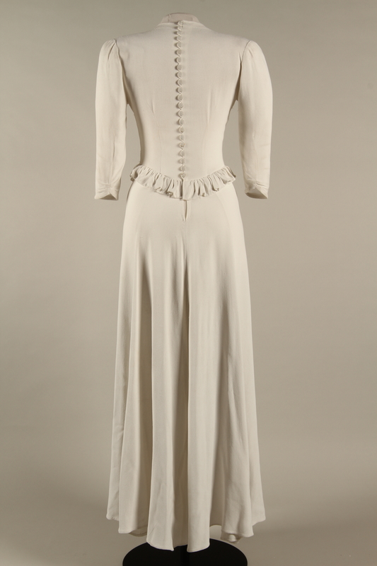 2005.579.2 back Wedding dress with ruffle made for the marriage of 2 German Jewish DP camp aid workers
