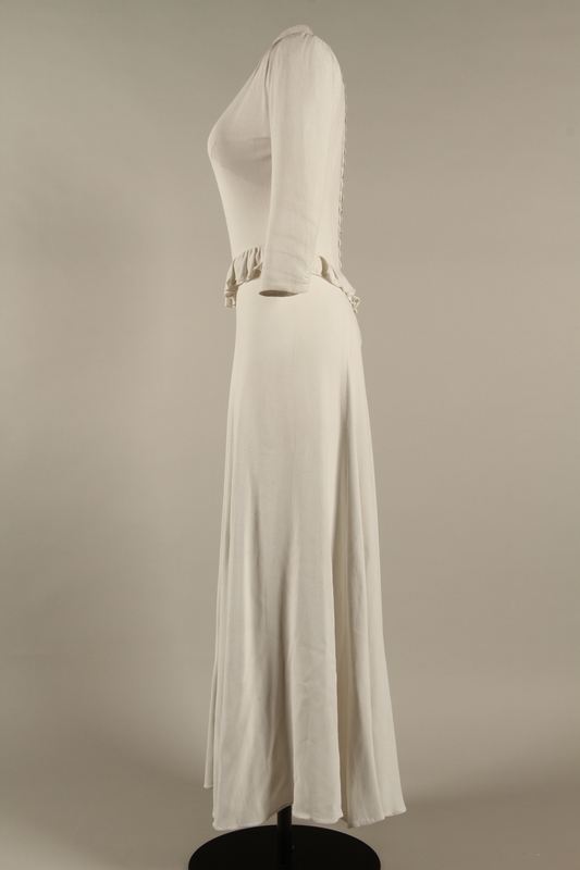 2005.579.2 left Wedding dress with ruffle made for the marriage of 2 German Jewish DP camp aid workers