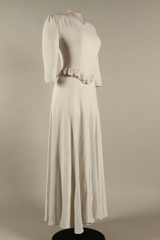 2005.579.2 3/4 right Wedding dress with ruffle made for the marriage of 2 German Jewish DP camp aid workers