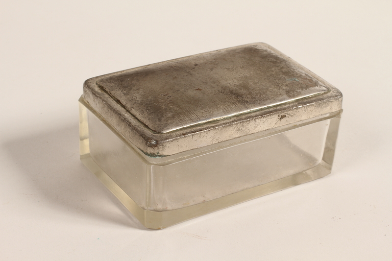 2005.579.19_a-b closed Glass keepsake box with a silver lid used by a German Jewish refugee nurse and postwar aid worker in Bergen-Belsen DP camp