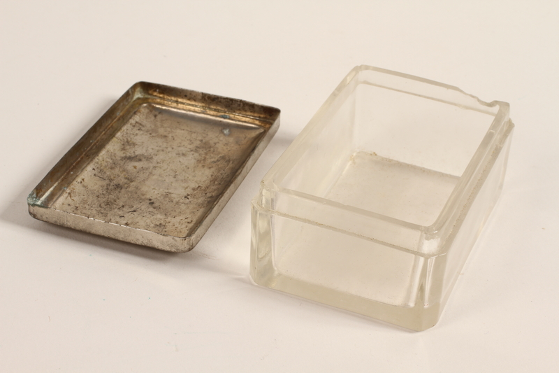 2005.579.19_a-b open Glass keepsake box with a silver lid used by a German Jewish refugee nurse and postwar aid worker in Bergen-Belsen DP camp