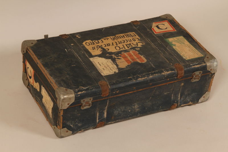 2004.286.2 back Dark blue paper covered suitcase used by a Jewish refugee