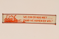 2006.221.2 front Victory ribbon distributed by Canadian troops in the Netherlands given to a young child who had lived in hiding  Click to enlarge