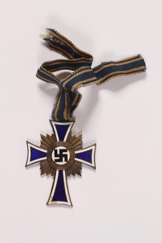 2007.243.1 front Ehrenkreuz der Deutschen Mutter [Cross of Honor of the German Mother] medal, 3rd Class Order, Bronze Cross