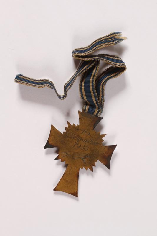 2007.243.1 back Ehrenkreuz der Deutschen Mutter [Cross of Honor of the German Mother] medal, 3rd Class Order, Bronze Cross