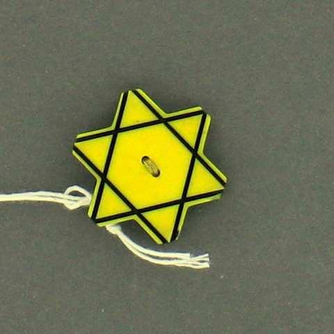 Plastic Star of David button worn to identify a Bulgarian Jew