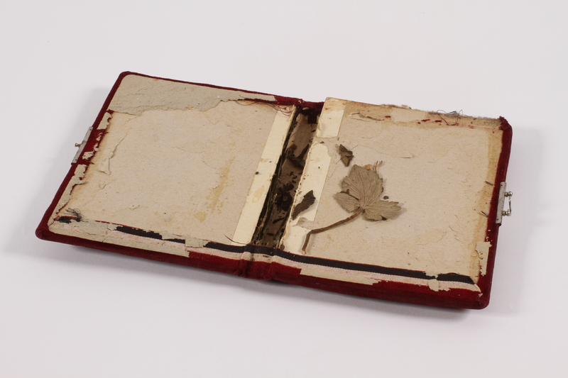 2014.512.3 open Notebook cover used by a Kindertransport refugee girl