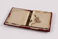 2014.512.3 open Notebook cover used by a Kindertransport refugee girl  Click to enlarge