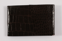 2013.486.18 back Faux alligator photo wallet used by a young German Jewish refugee  Click to enlarge