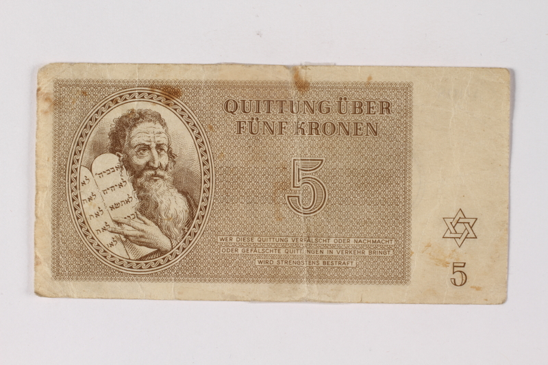 2013.523.3  front Theresienstadt ghetto-labor camp scrip, 5 kronen note, owned by a German Jewish survivor