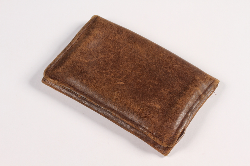 2015.519.2 front Brown leather wallet used by a Holocaust survivor postwar