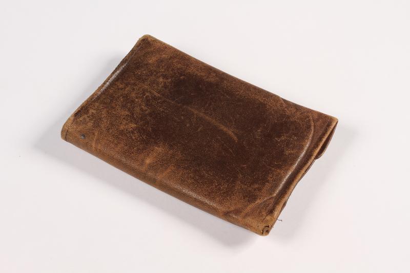 2015.519.2 back Brown leather wallet used by a Holocaust survivor postwar