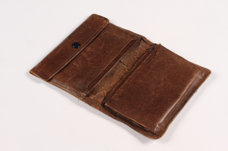 2015.519.2 open Brown leather wallet used by a Holocaust survivor postwar