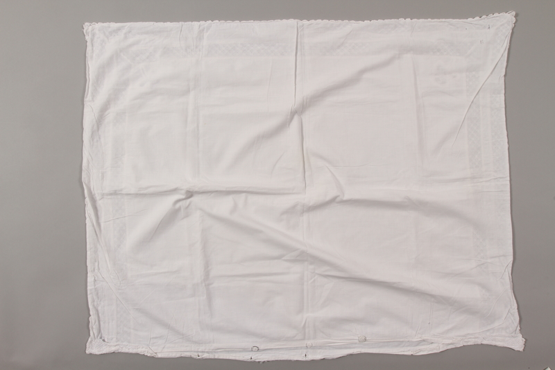 2012.342.4 back White lace pillowcase returned to Czech Jewish concentration camp inmates postwar
